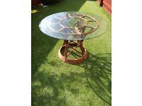 Unique glass top, wicker base, round table