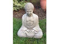 Stone garden buddha statue, lovely detail. New