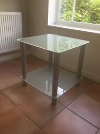 Occasional table with frosted glass top and shelf and silver satin finish legs H55cms W56cms D56cms
