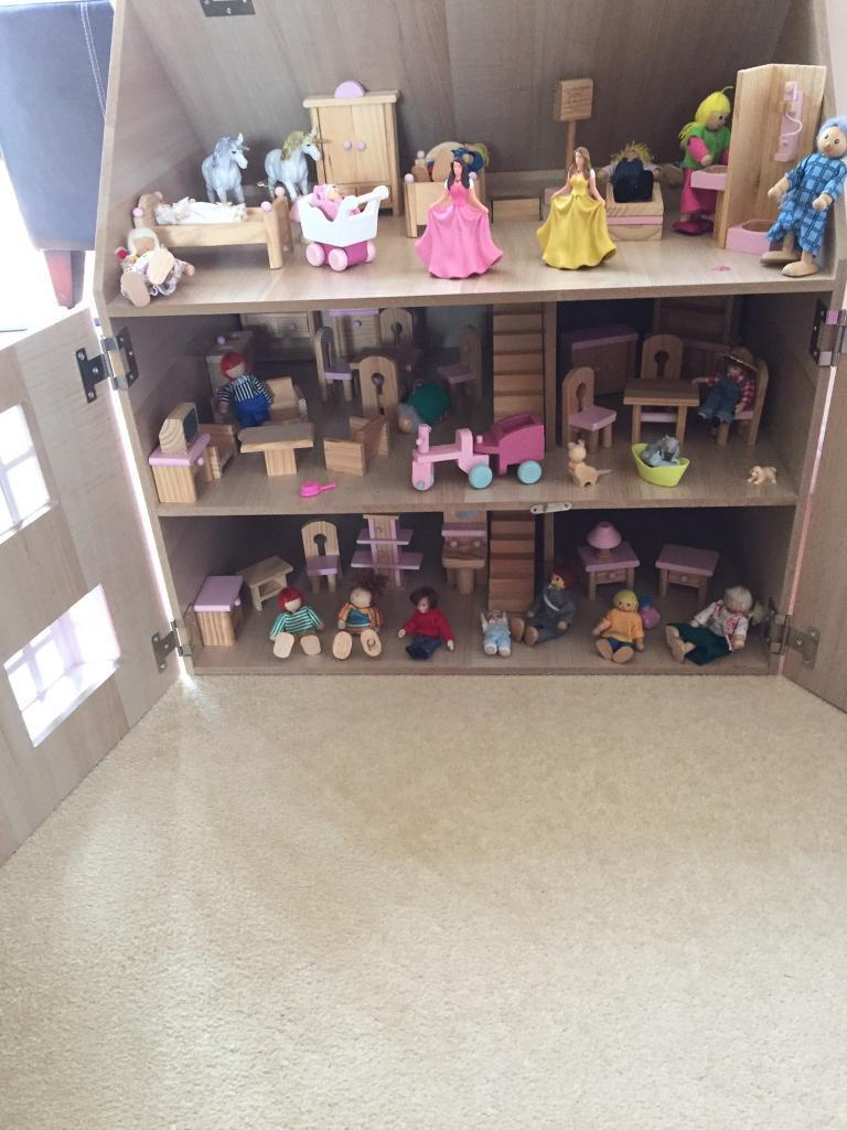 Wooden dolls house with furniture and accessories