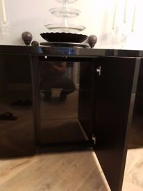 Large black sideboard with glass top