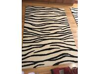 2 zebra print rugs 1 big one a bit smaller for sale
