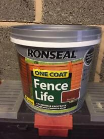 Brand new tubs of fence paint
