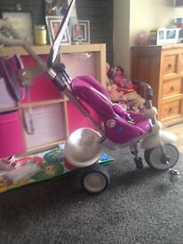 Purple and white smart trike
