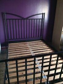 Double black iron bed no mattress