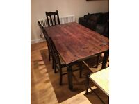 Dining room table and 6 matching chairs. Dark stained pine. 2.4m x 91cm (extended). Well used.