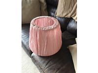 2 lampshades one pink one blue and white striped.