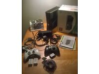 Xbox 360 + 6 games and two controllers with charger packs and charger cable