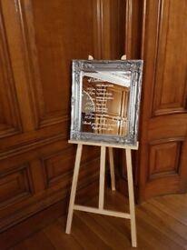Large silver ornate mirrors wedding table plan