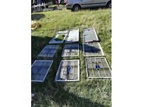 Collection of stained glass windows. Metal framed. Broken glass on some windows.