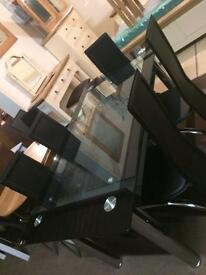 New glass table £180 chairs £35 each