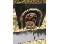 Cast iron fireplace / insert / hearth / fire back