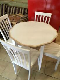 Wood table and 4 wood chairs 90cm wide. Solid wood ,good size not to big.