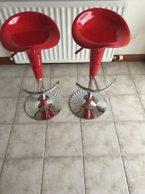 2 red kitchen bar stools.