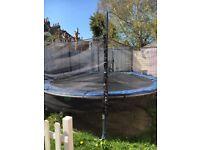 12 foot trampoline & net & ladder