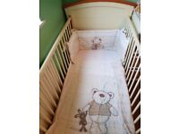 Cot bed, changing unit, nappy stacker and wall prints