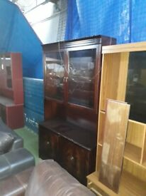 wall unit in dark brown wood with glass doors at the top