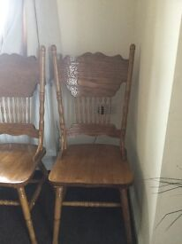4 solid pine carved chairs