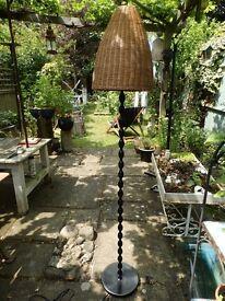 Floorlamp, decorative metal and wicker shade.