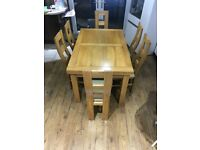 Solid Oak extendable dining table with 6 leather chairs (free local delivery)