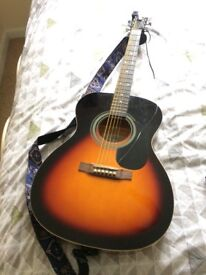 Great guitar with bag, capo and tuner