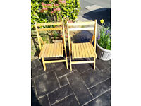 A Pair Of Folding Garden Chairs