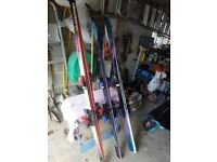3 pairs of skiis plus bindings, poles and ski bag