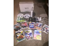 Nintendo Wii with 8 games and all accesories