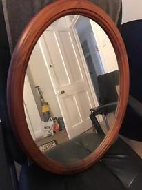 Large oval mirror with wooden frame