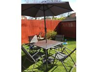 Patio table with 4 reclining chairs, parosal and base