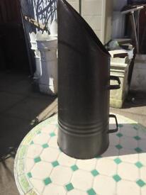 Black metal coal scuttle.