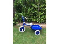 Child's Tricycle in blue with tipping trailer