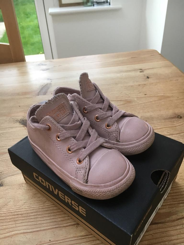 df73cf82bc565b Girls rose gold size 7 converse trainers
