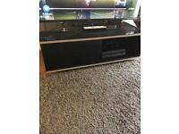 Brilliant condition black gloss tv stand with 2 sliding doors compartments