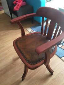 Vintage leather chair with wheels
