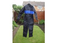 LINTEK MOTORCYCLE ONE PIECE NYLON RAIN SUITE SIZE LARGE in BLACK with BLUE STRIPE.