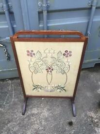 Antique fire screen with very detailed embroidery