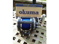 TITUS OKUMA Platinum Series Lever Drag Trolling Reel. IN BOX - BRAND NEW