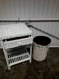 White wicker side table and laundry bin