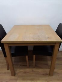 Table & 2 brown faux leather chairs