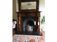Mahogany fireplace with cast iron inset with matching over mantle mirror