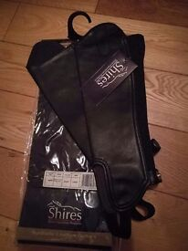 "Black synthetic leather chaps/ gaiters. 13"" high and 10.5"" width. Brand new with tags."