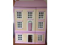 3 storey wooden dolls house with furniture and figures.