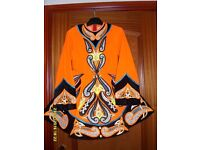 Striking orange/black Irish Dancing dress - very unusual, beautiful design. Suit approx 11-14 years.