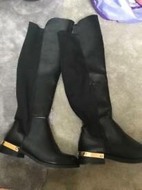 Woman's knee high boots.