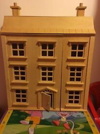 Wooden dolls house complete with accessories