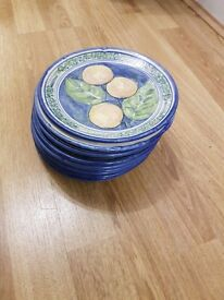 A set of 10 handmade pottery side plates from Zimababwe