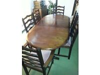 dark solid oak oval dining table with 4 chairs and 2 carvers