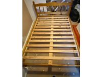 Wooden double bed with mattress