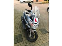 For Sale: 2010 Honda PCX 125. Silver. In good condition, good commuter and comfortable.